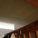 An upstairs leak had resulted water damage to the below garage ceiling. Once the damaged materials were removed we rebuilt the ceiling and matched the texture perfectly.